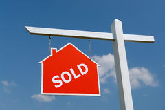 House Sold Signpost Stock Photo