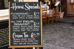House Specials Menu Board. In England with a street cafe in the background Stock Photo