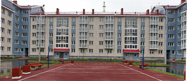 House with a sports ground Stock Images