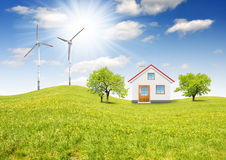 The house in spring landscape. With wind turbine Stock Image