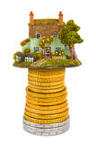 House and stack of coins Royalty Free Stock Images