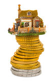 House and stack of coins royalty free stock photography