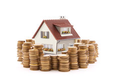House with stack of coins Stock Photos