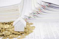 House with stack of gold coins on finance account Stock Images