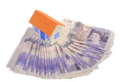 House and stack of money Royalty Free Stock Photos