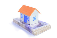 House and stack of money Royalty Free Stock Photo