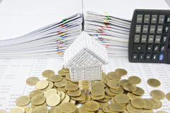 House on stack silver and gold coins Stock Photo