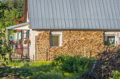 House with stacked split firewood Stock Photography