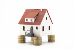 House on stacks of coins Stock Photo