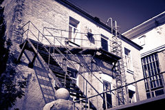 House with stairs. Old brick house with stairs behind the wall Stock Image