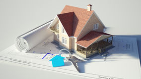 House standing on the blueprints Royalty Free Stock Photo