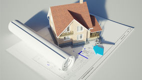 House standing on the blueprints Royalty Free Stock Photography