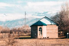 House standing in a field against the mountains royalty free stock photography