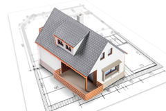 House standing on plan or blueprints Royalty Free Stock Image
