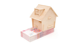 House stands on stack of RMB paper currency Royalty Free Stock Image