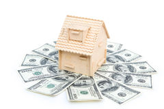 House stands on stack of USD paper currency Stock Photos