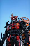 The statue of Transformer is in imagine of person to made a steel. stock photos