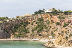 House on steep coast, Algarve in Portugal Stock Photography