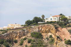 House on steep coast, Algarve in Portugal Royalty Free Stock Photo