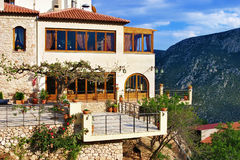 House on a steep slope of Mount Parnassus, Delphi Stock Images
