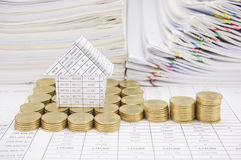 House with step of gold coins on finance account Royalty Free Stock Image