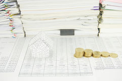 House and step of gold coins have paperwork as background Royalty Free Stock Photo