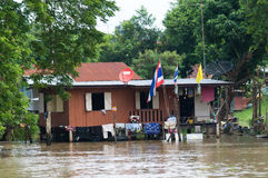 House on stilts during a flood in Thailand royalty free stock photos
