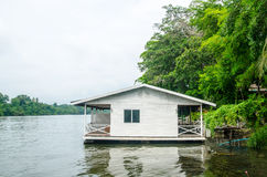 House on stilts over the river Stock Image