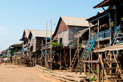 House on stilts with street. In Cambodia Royalty Free Stock Photo