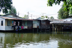House on stilts. Views of the city's Slums from the river. In Bangkok, Thailand Royalty Free Stock Photos