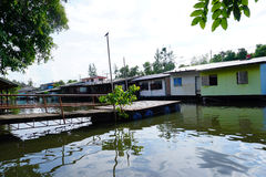 House on stilts. Views of the city's Slums from the river. In Bangkok, Thailand Royalty Free Stock Image