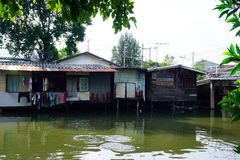 House on stilts. Views of the city's Slums from the river. In Bangkok, Thailand Stock Image