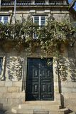 House with stone vine tree. Balcony with iron handrail and vine tree. Santiago de Compostela, Spain. royalty free stock image
