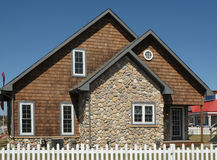 House with a stone wall Royalty Free Stock Image