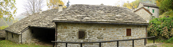 House with stones roof Stock Image