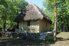 House with straw roof in Dimitrie Gusti National Village Museum in Bucharest Stock Photography