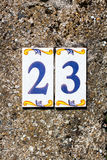 House street address with a 23 Mediterranean-style ornate number Royalty Free Stock Image