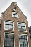 House in in a street by a canal in Amsterdam Royalty Free Stock Image