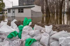 House submerged by water during floods. With sand bags in the foreground stock images