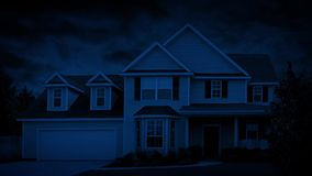 House In Suburbs On Windy Nightse At Night. Typical suburban house with trees blowing in the wind stock footage