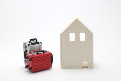 House and suitcases on white background. Vacation rentals, renting private homes and rooms Stock Photos
