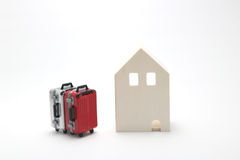 House and suitcases on white background. Vacation rentals, renting private homes and rooms Stock Photography