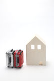 House and suitcases on white background. Vacation rentals, renting private homes and rooms Royalty Free Stock Images