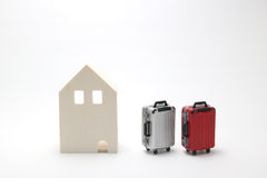 House and suitcases on white background. Vacation rentals, renting private homes and rooms Royalty Free Stock Image