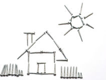 House and sun made by screws. Concept Royalty Free Stock Photo