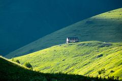 Mountain camp in the beautiful mountain valley of Chauchi. House in the sunlight, in a green mountain valley. Mountain camp Royalty Free Stock Photo