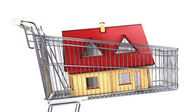 House in a supermarket trolley. Close up side view, on white background. Clipping path included Royalty Free Stock Photo