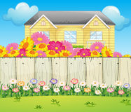 A house surrounded with colorful flowers Stock Photography