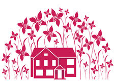 House surrounded by flowers Royalty Free Stock Photography