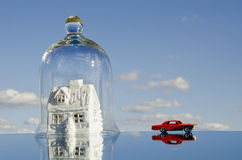 House symbol with car toy on mirror Royalty Free Stock Images